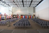 A Conference center with a lot of chairs taken from stage