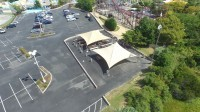 An overhead shot of a parking lot next to an amusement park