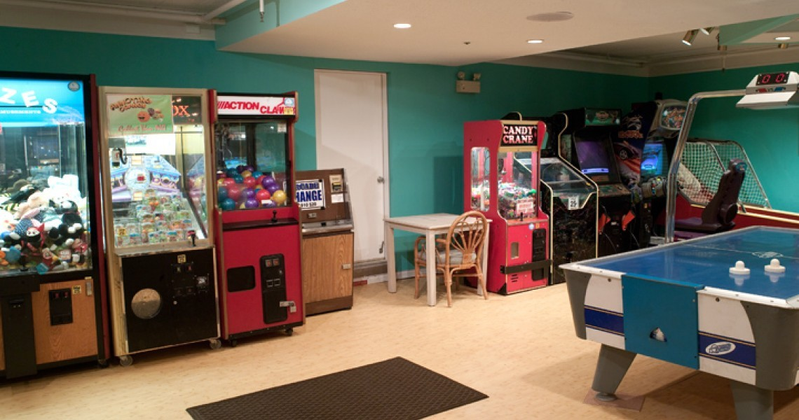 A Game room with Pool and arcade machines