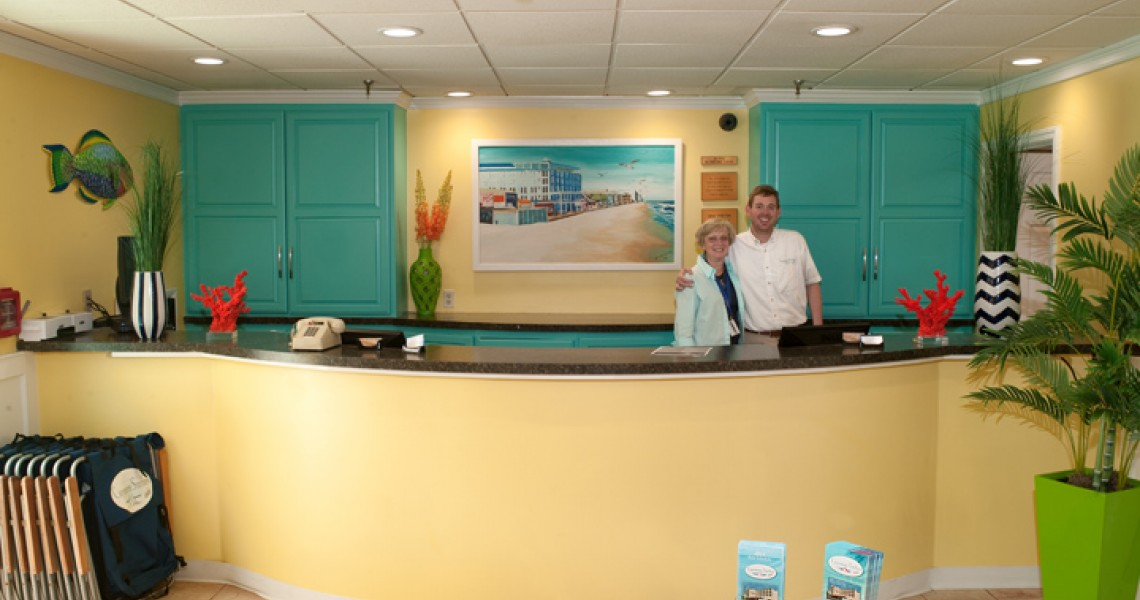 A front desk with a couple working behind it