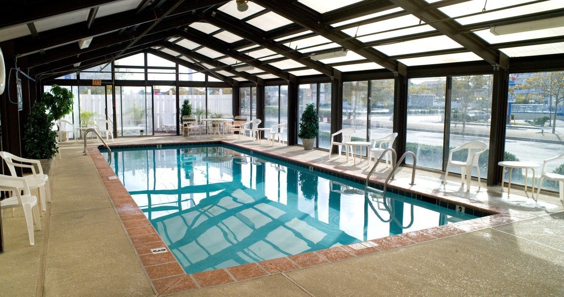 A glass enclosed indoor pool near the street