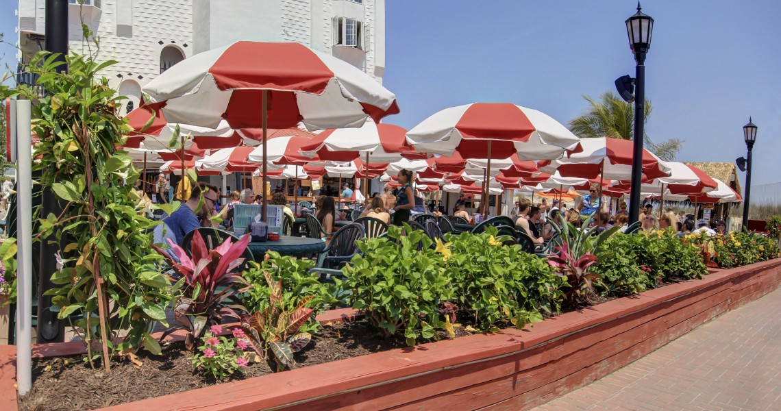 Red and white umbrellas over a restaurant area