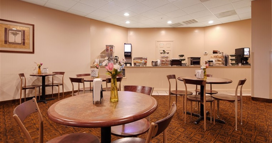 A continental breakfast buffet in front of a seating area
