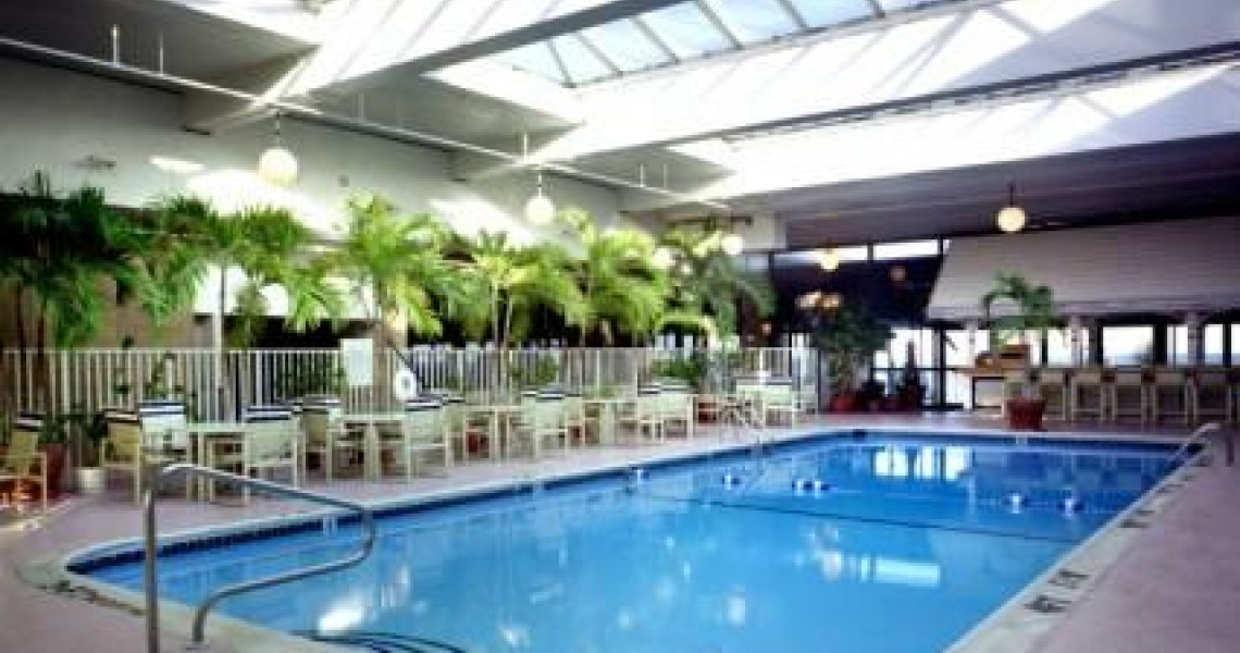A glass roof over an indoor pool