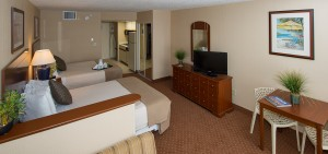 Facing the interior of a hotel room with two twin beds