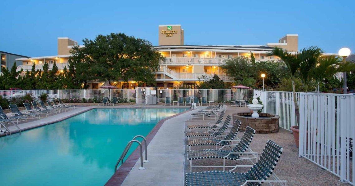 An outdoor pool near the Quality Inn Hotel