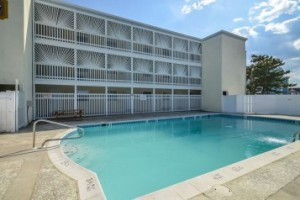 A 3 Story rental complex with an outdoor pool