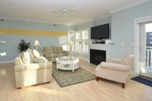 A light blue room with a yellow stripe and wood flooring